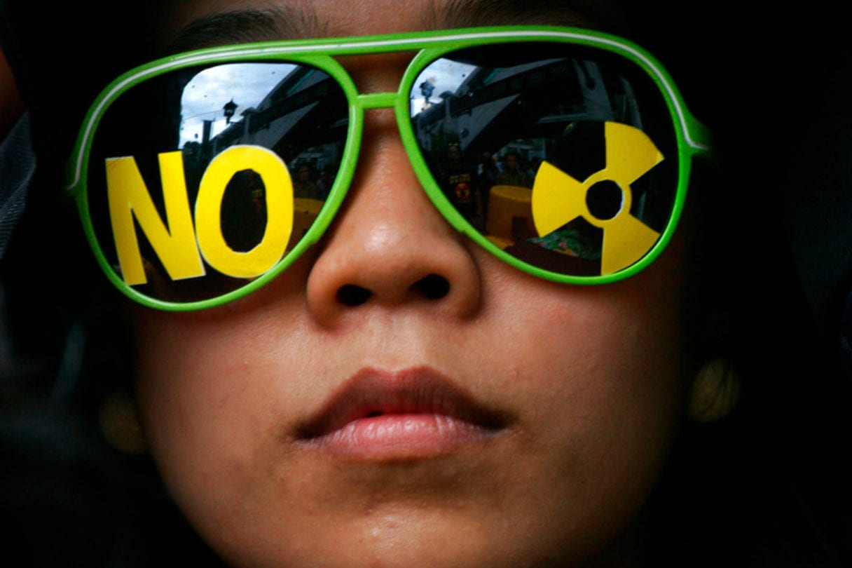 "Person with ""No nuclear"" symbol on their sunglasses"