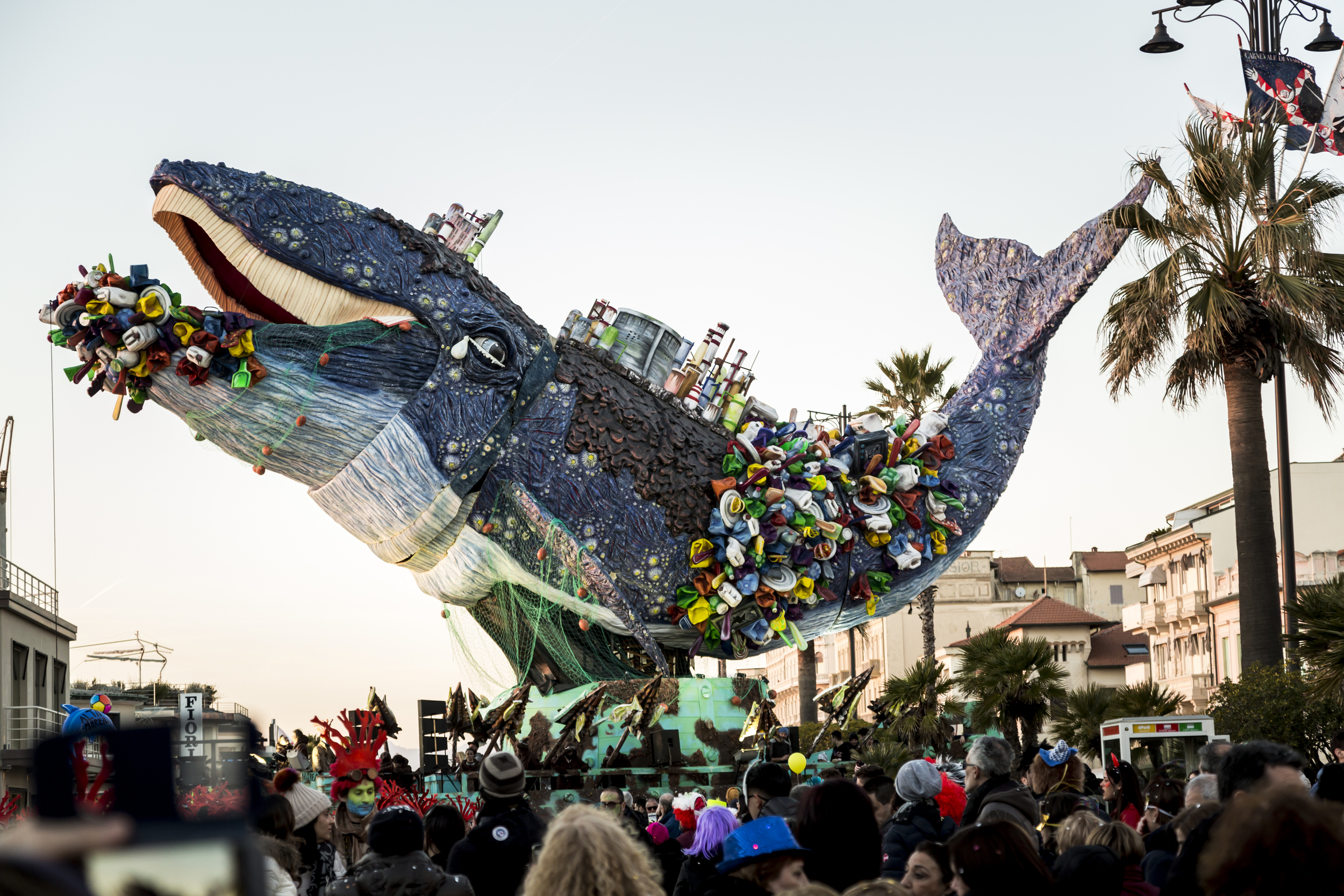 Giant sculpture of a whale dying from choking on plastic