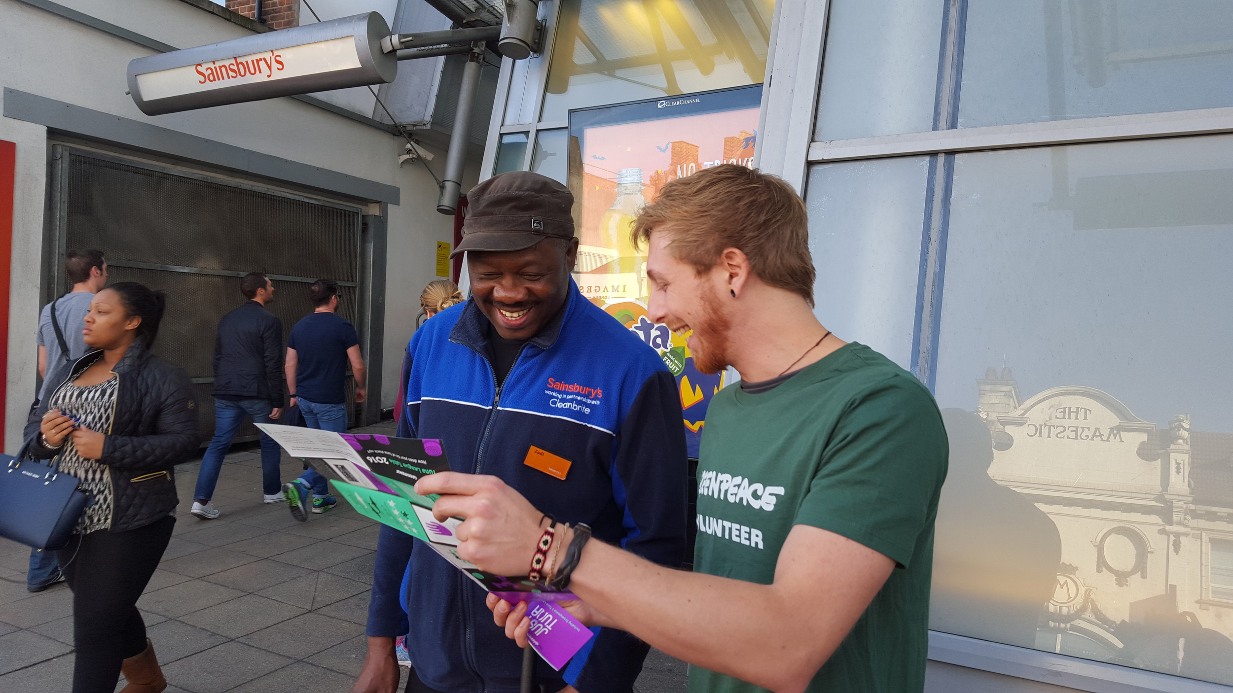 Greenpeace volunteer speaking to a member of the public