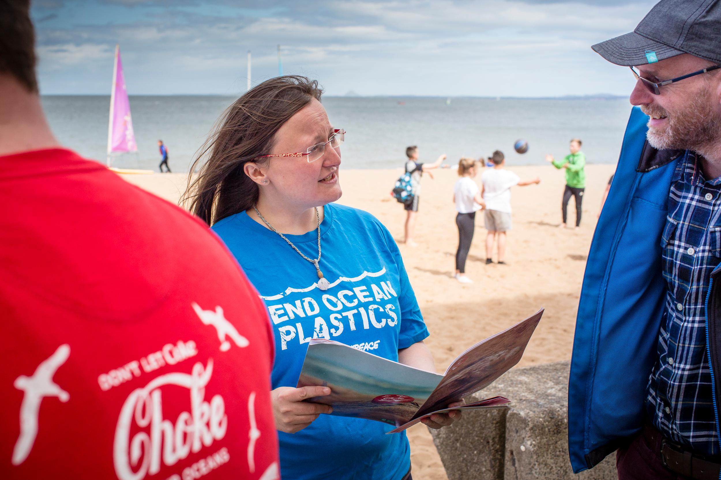 Greenpeace volunteers speak to members of the public