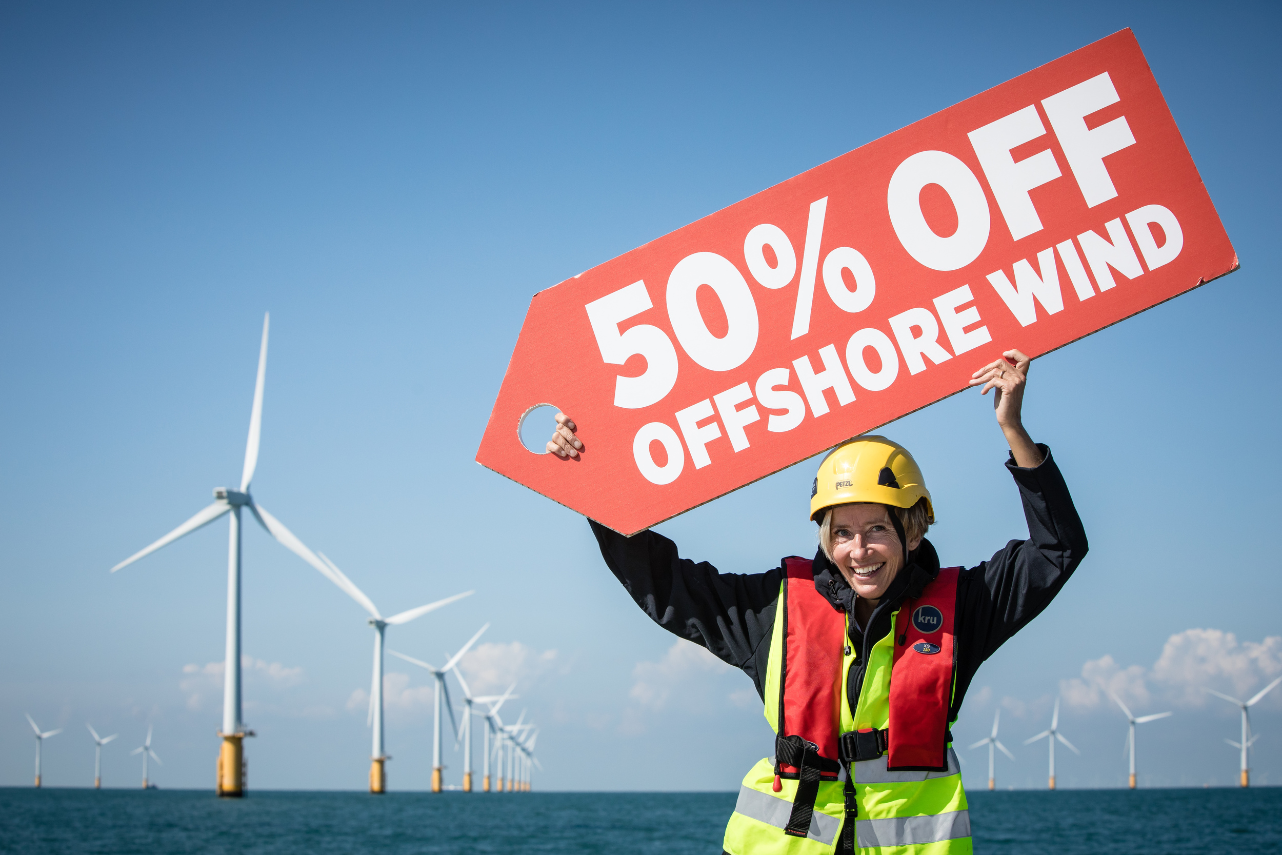 Emma Thompson holds up a sign reading 50 percent off offshore wind