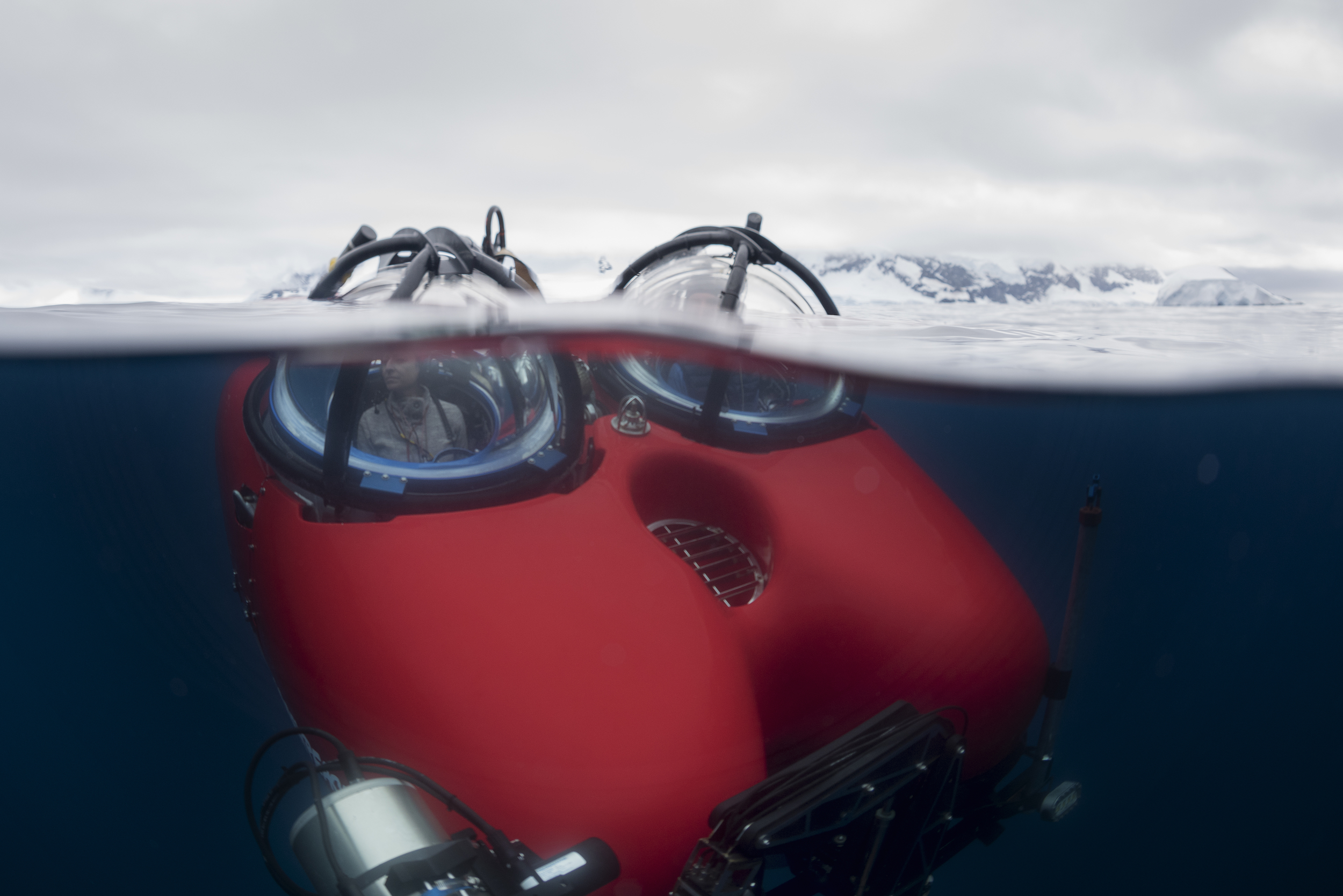 Red submarines partially submerged