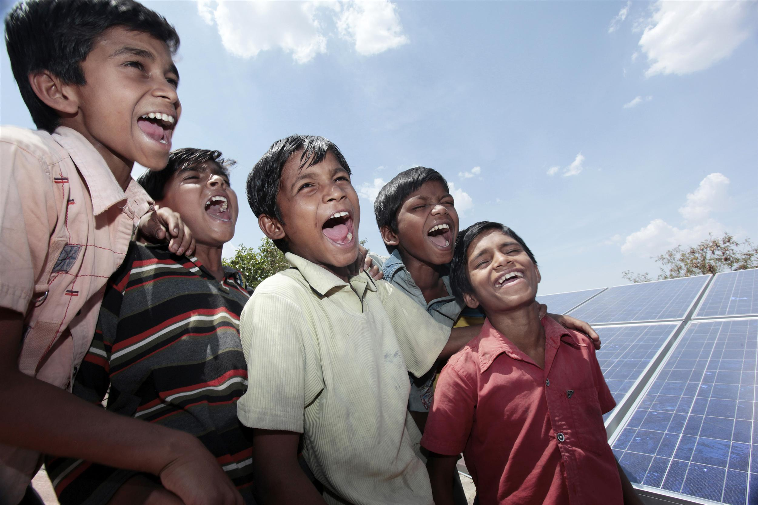 Children from India shouting for more solar power