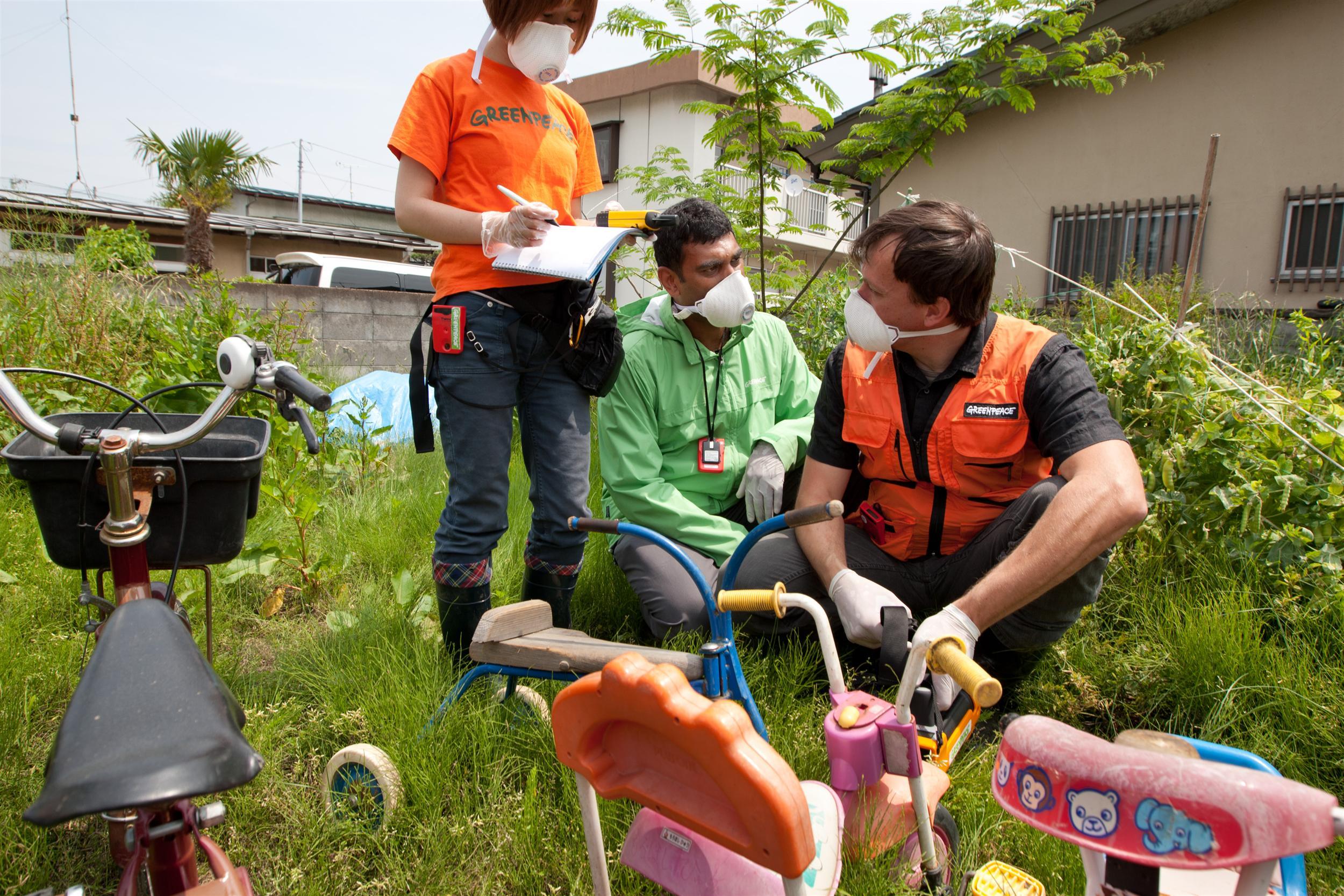 people conducting scientific tests in Fukushima