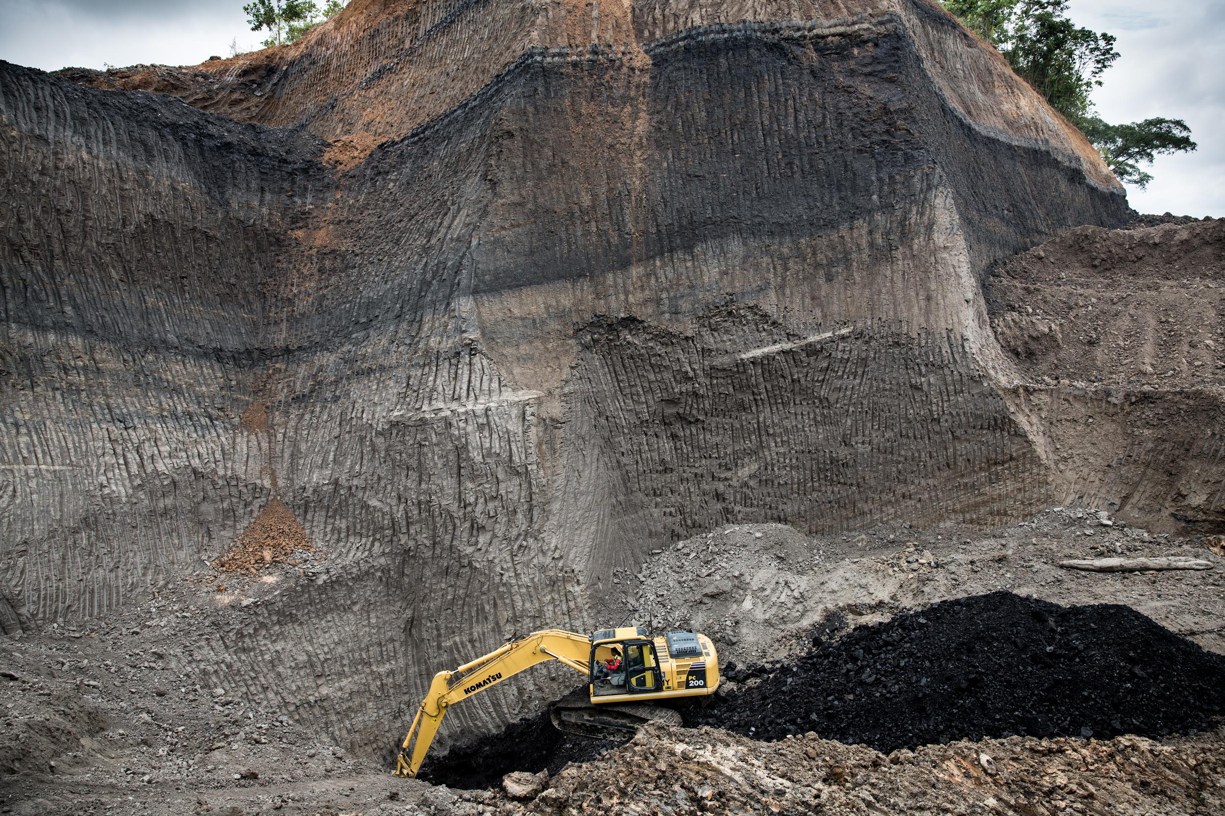 A digger in an open-pit Coal Mine in Kalimantan, Indonesia