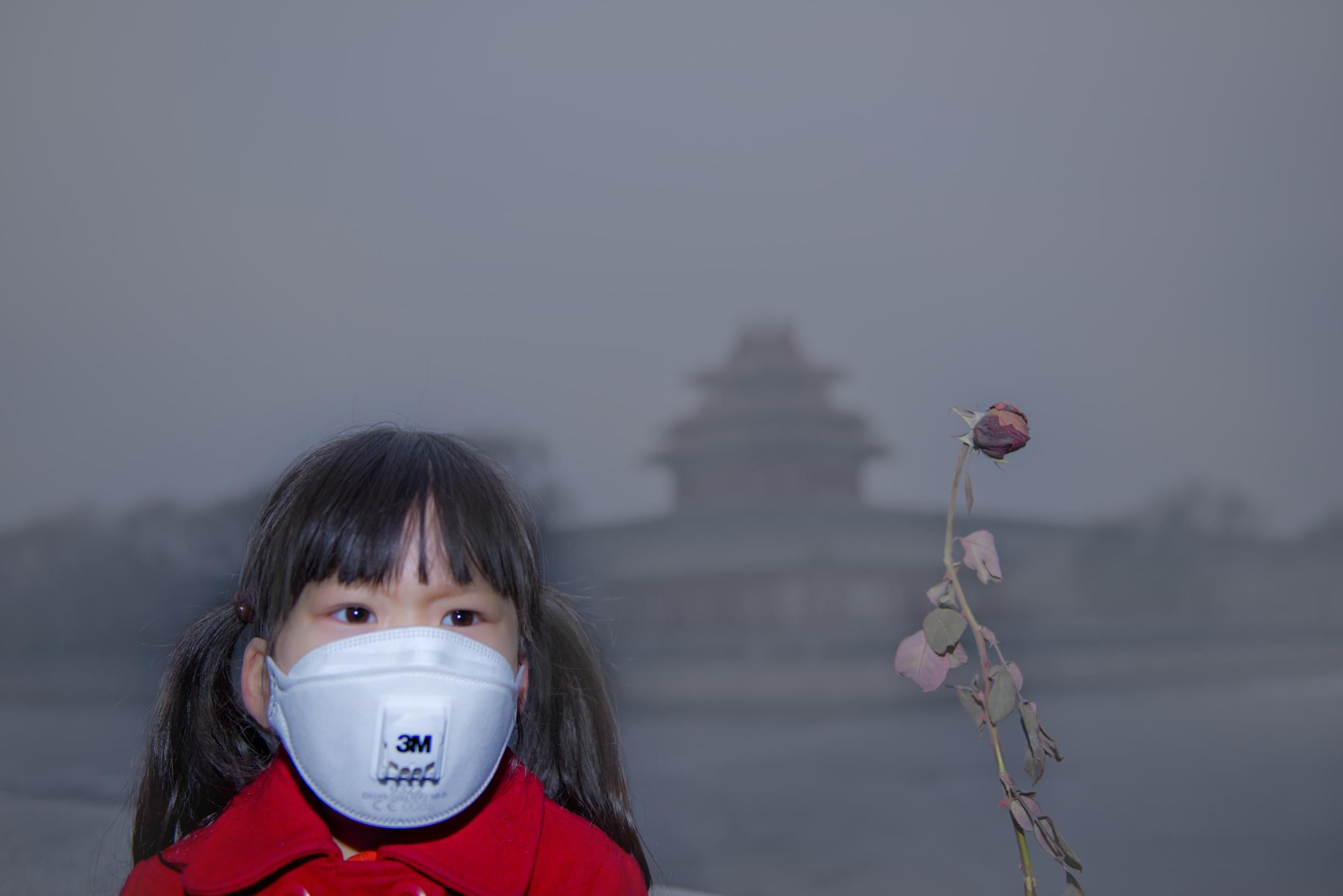 A girl wearing a respirator mask in Beijing,
