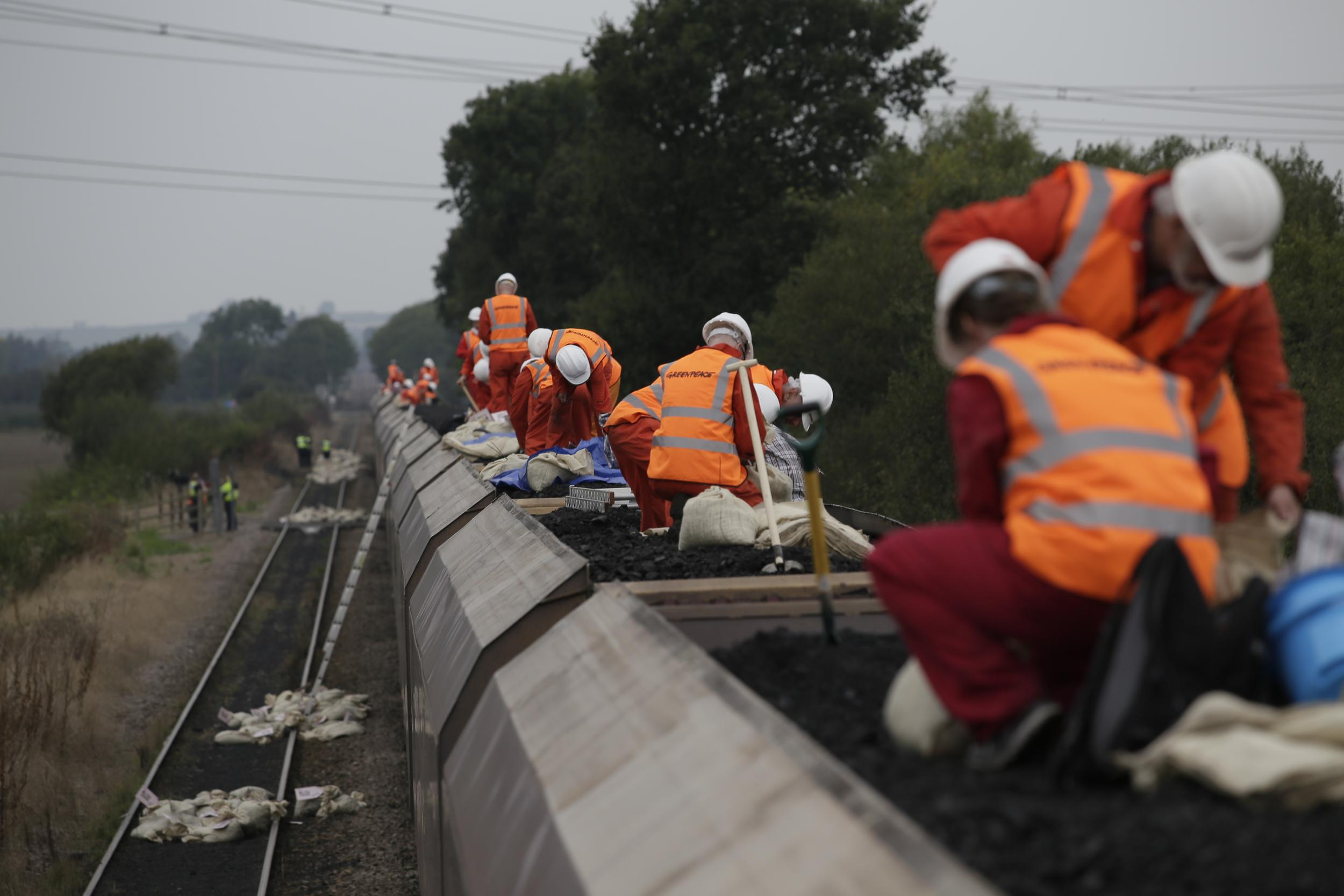 activists on top of a coal train during a protest at Cottam Power station, UK
