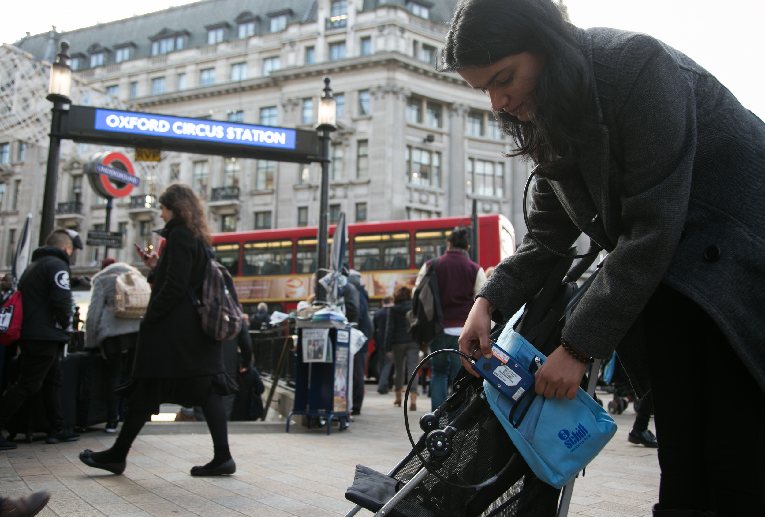 person with air pollution monitoring machine in London