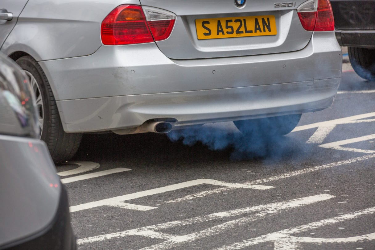 exhaust of a car with fumes coming out