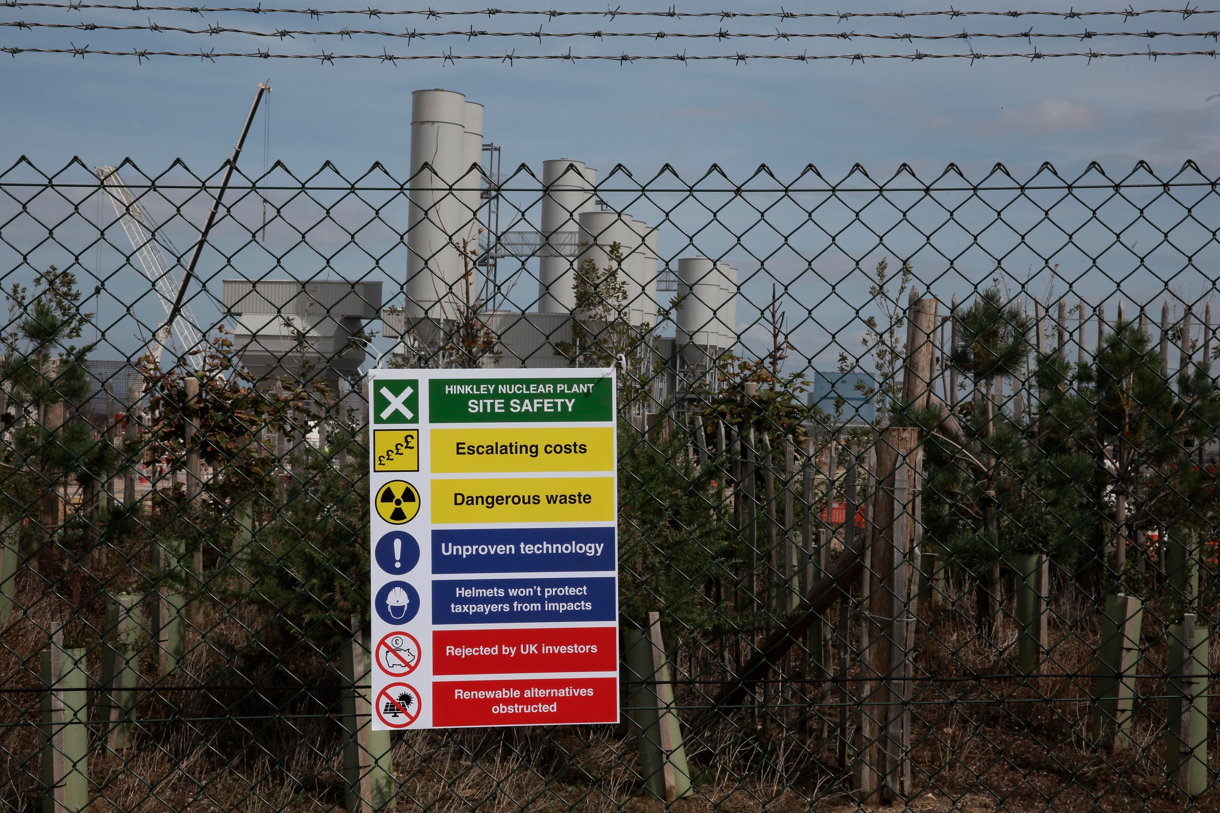 fence with Hinkley Point power station in the background