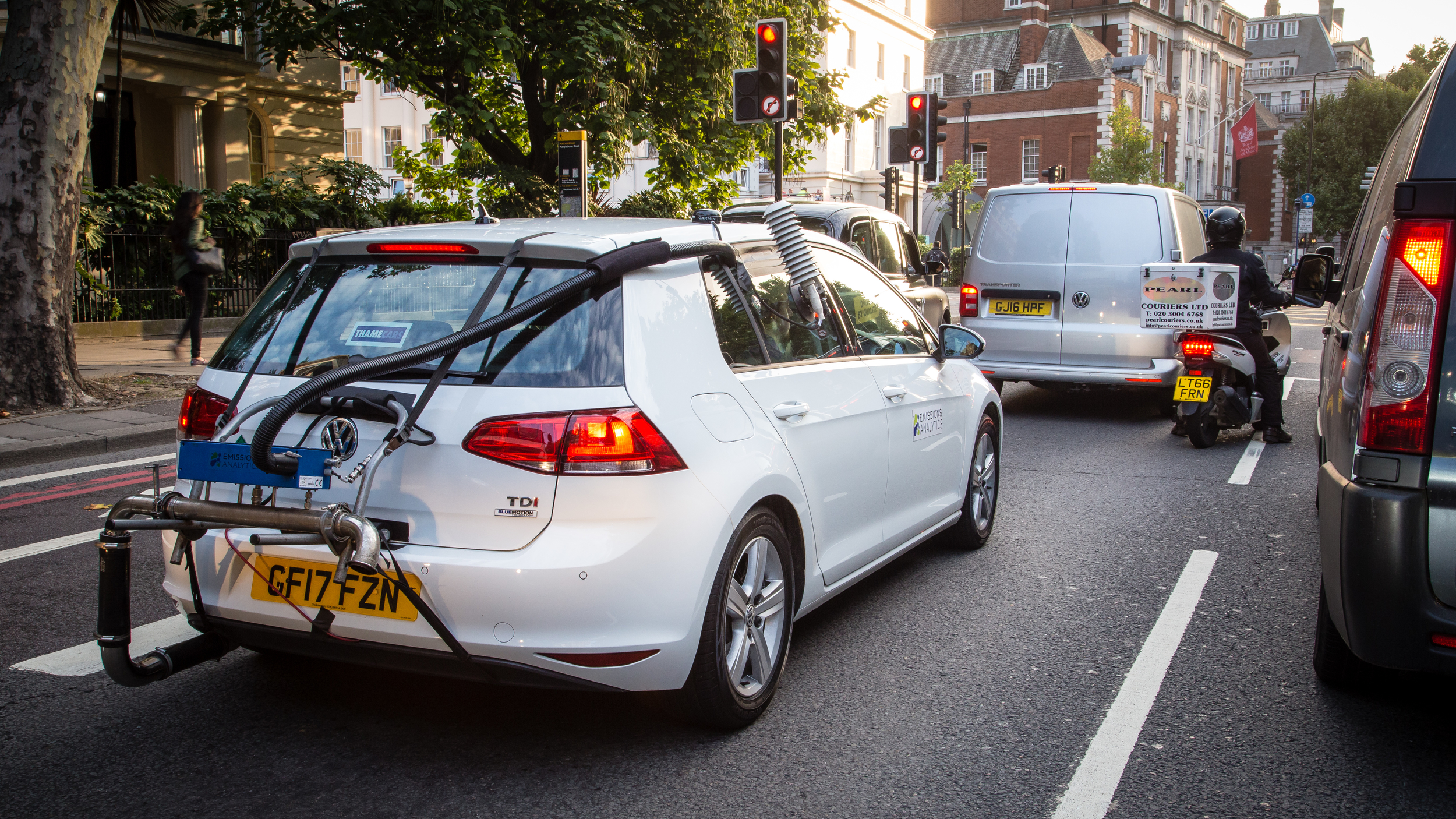 car with air pollution testing kit on