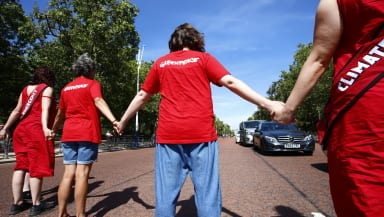 Greenpeace activists form human chain