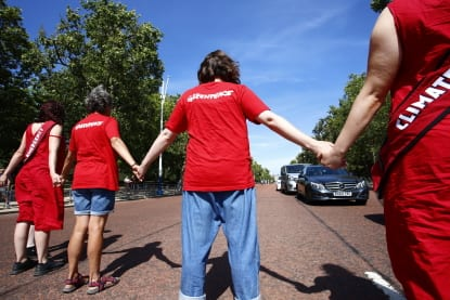 Greenpeace activists form human chain
