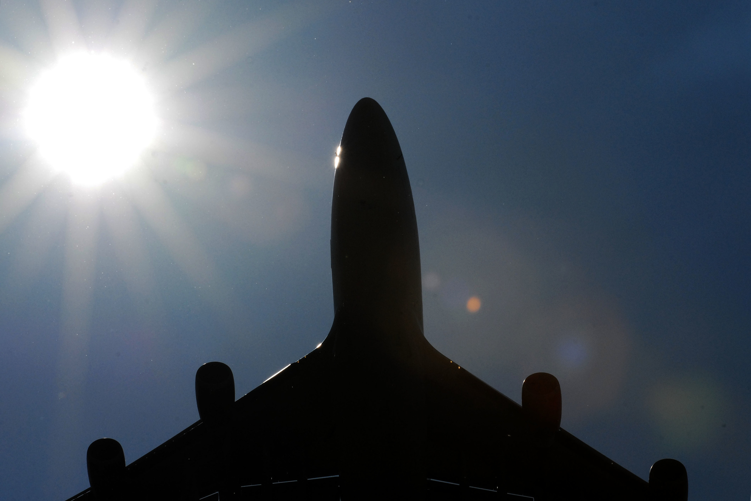 plane with sun in the background