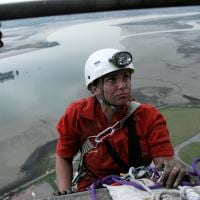 climber on side of power station