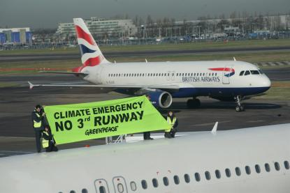 "Activists with ""no 3rd runway banner"" stand on top of plane"