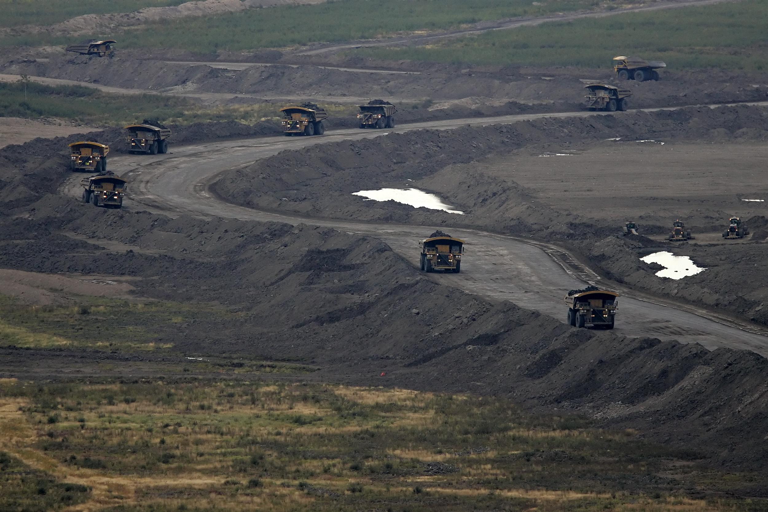 trucks in a bitumen mine