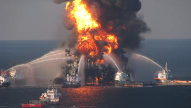 Fire response boats hosing water onto the burning deepwater horizon oil rig