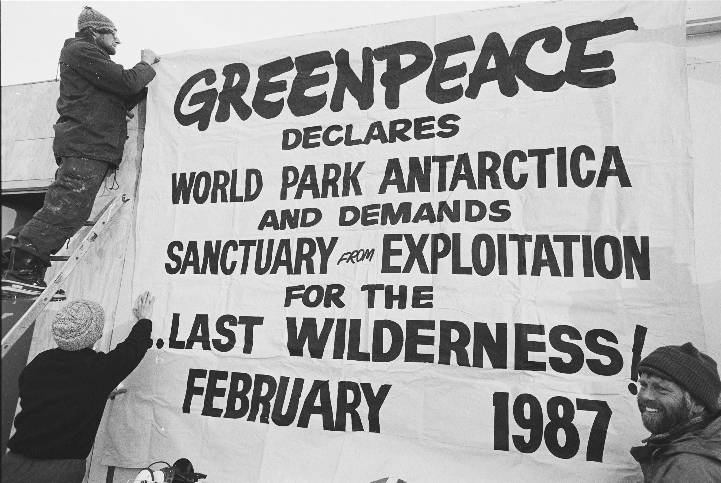 Sign saying greenpeace declares antarctic a world park