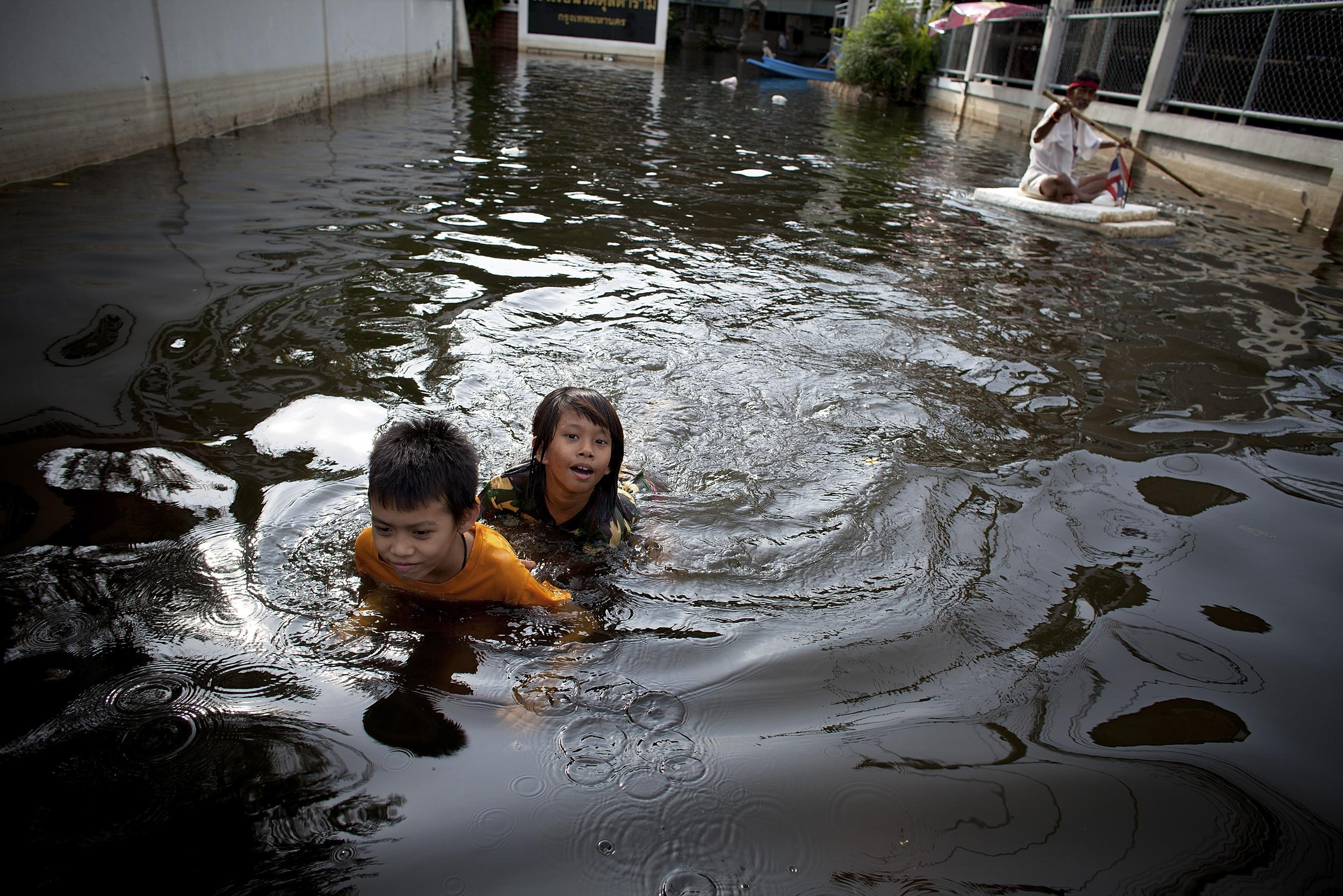 children in flooded area