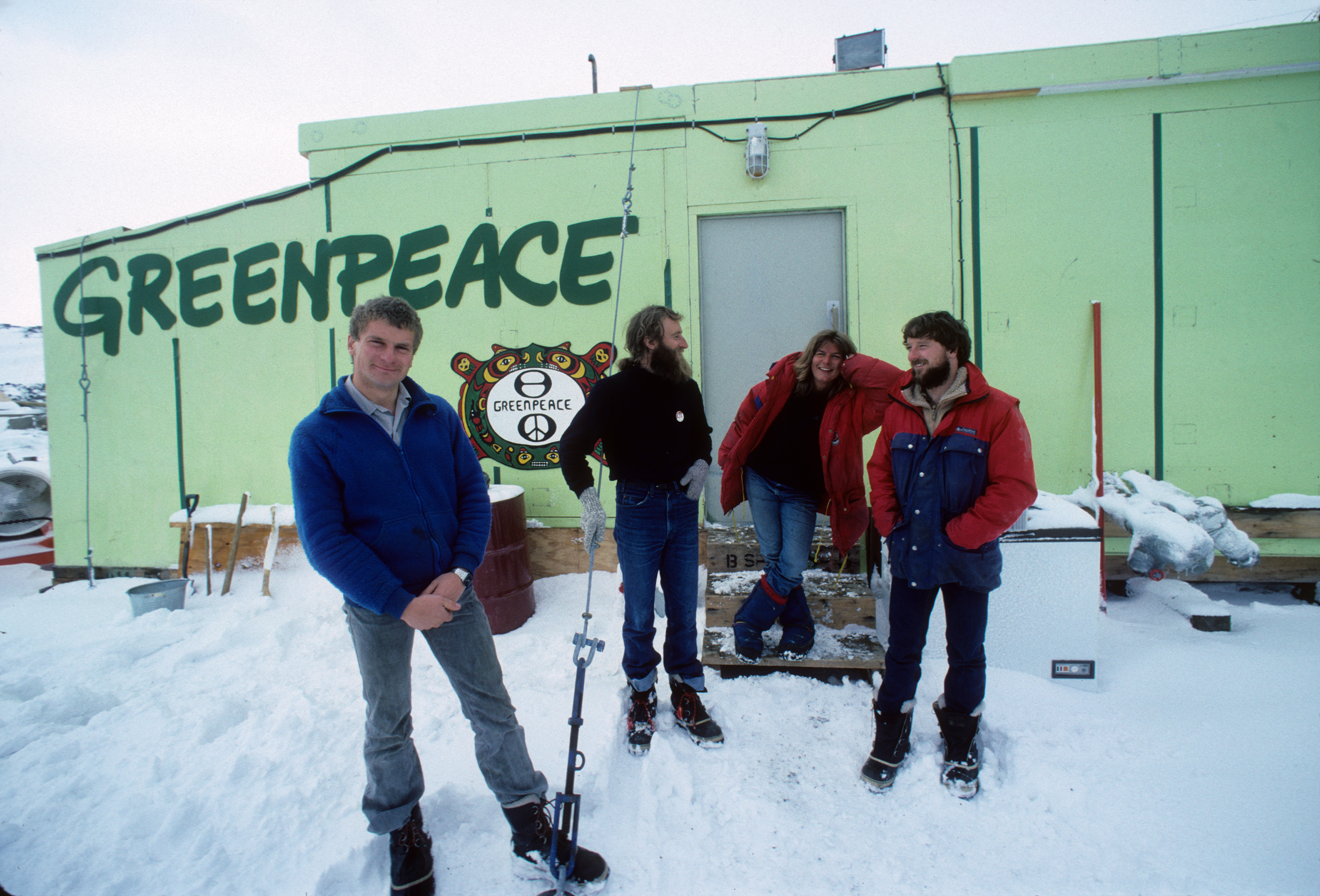 people outside research station in antarctic