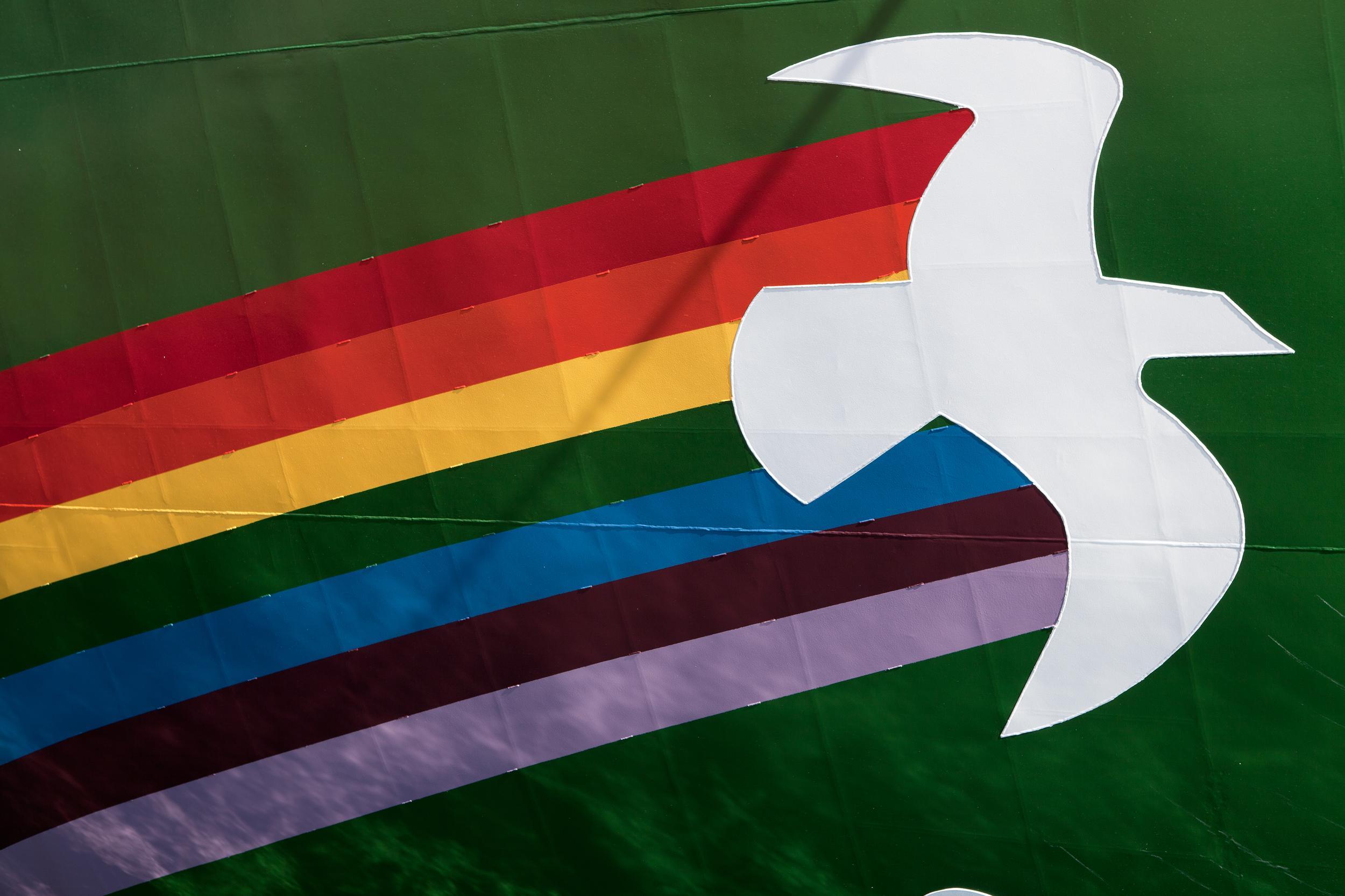 illustration of peace dove on a rainbow