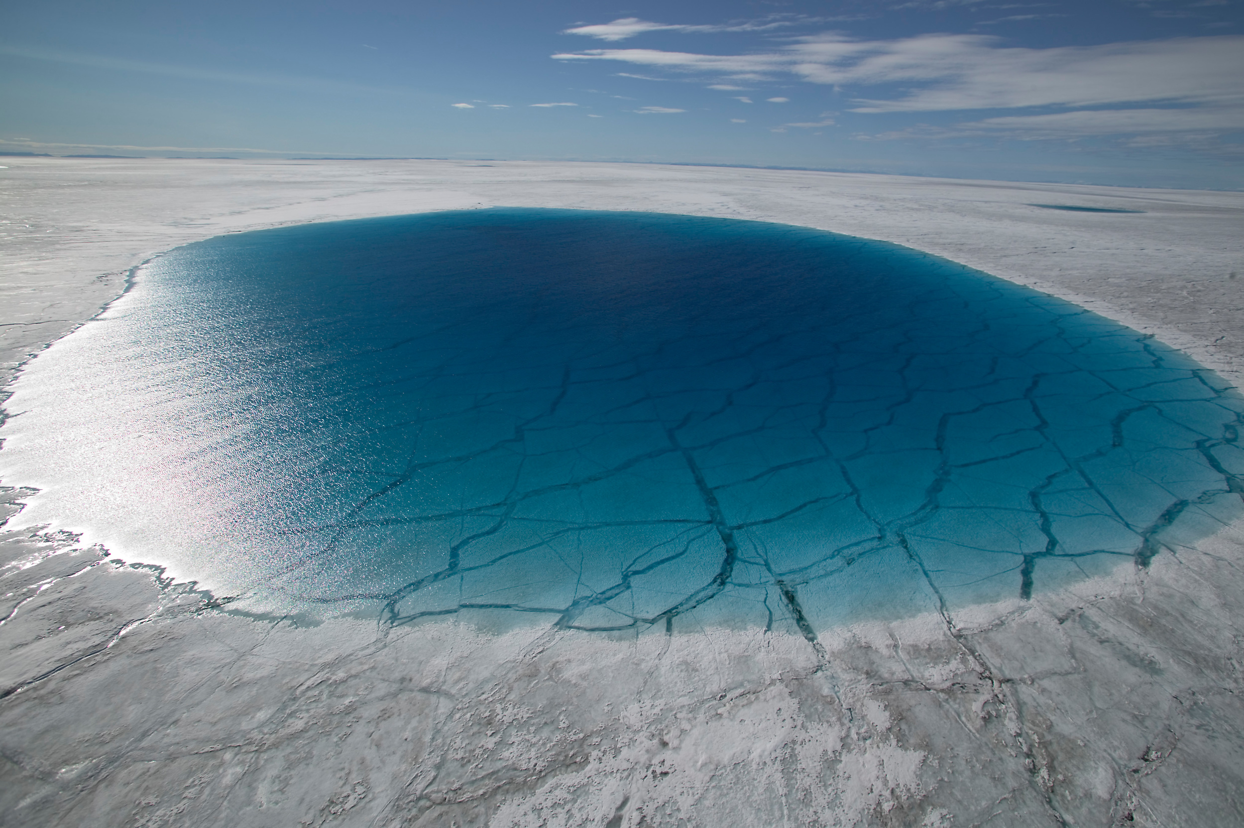 blue melt lake in the middle of ice