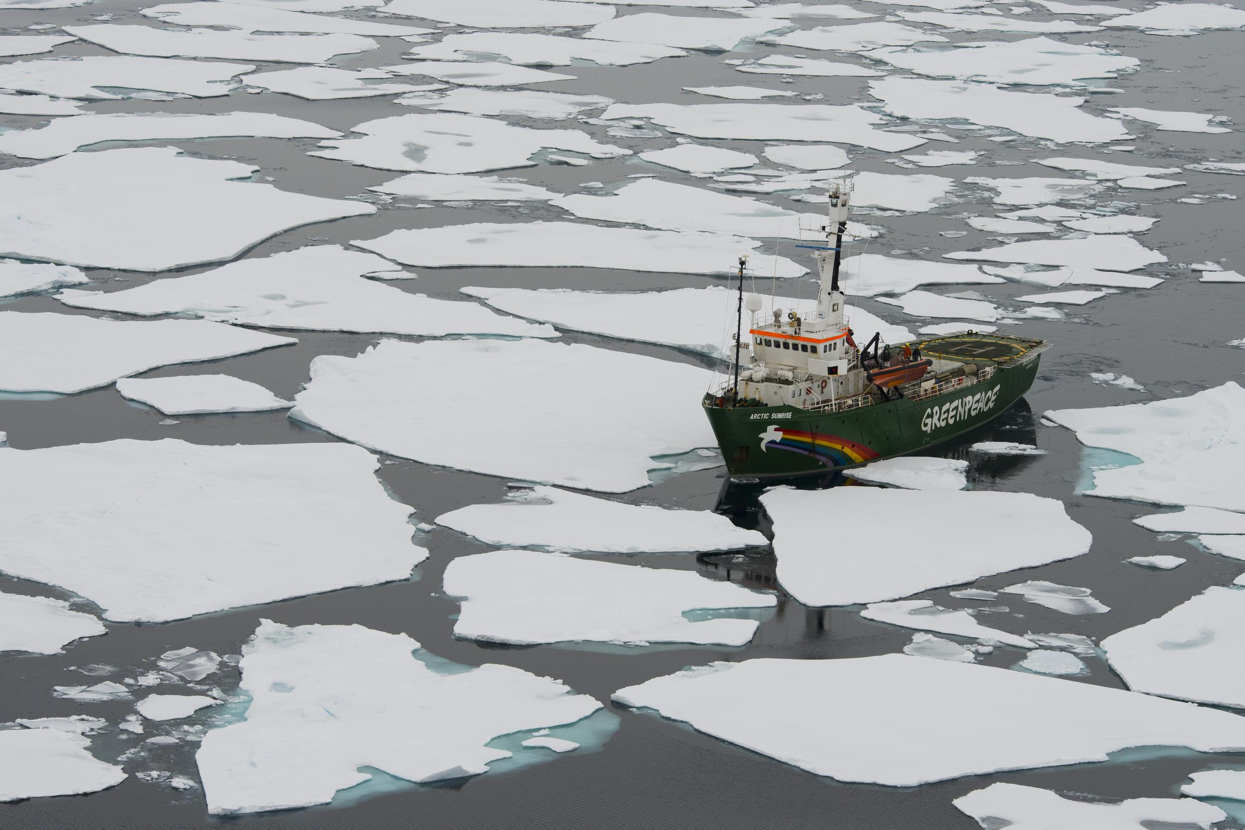 Greenpeace ship amidst ice floes in the Arctic