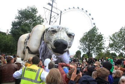 Giant polar bear puppet in front of London Eye