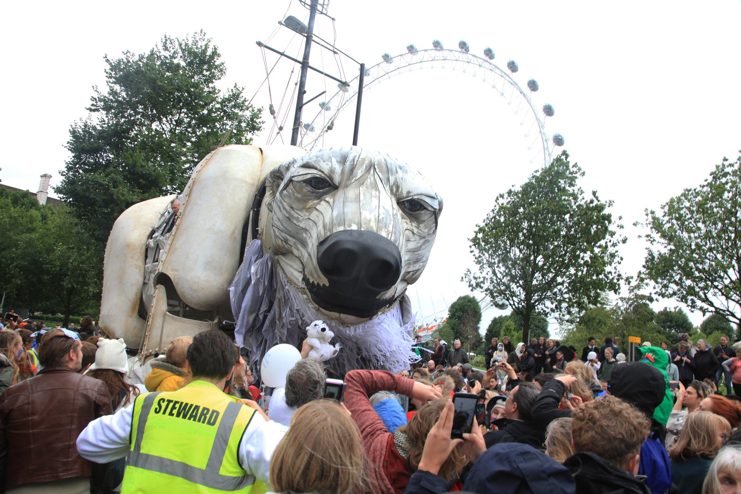 Giant polar bear puppet in front of London Eye