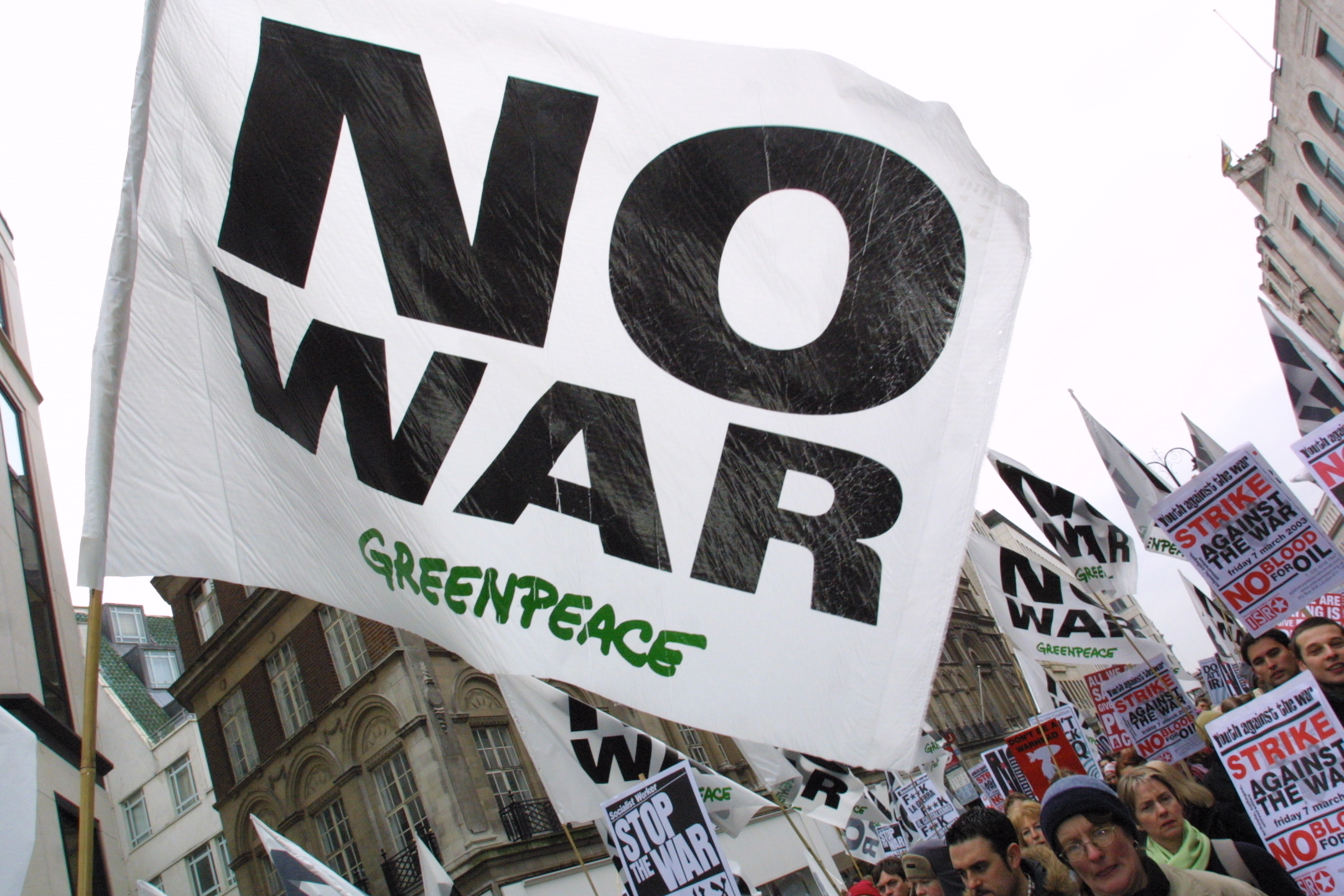 No War banner with greenpeace on it
