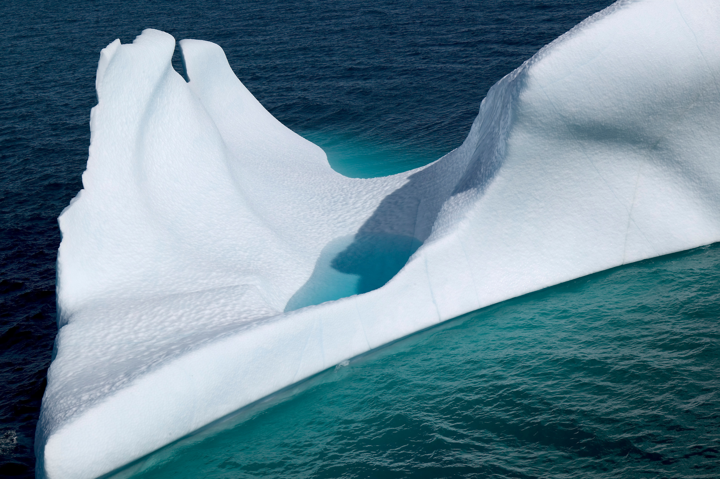 iceberg in clear blue water
