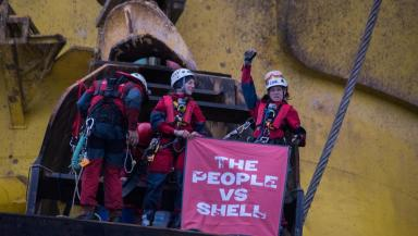 activists on top of oil rig