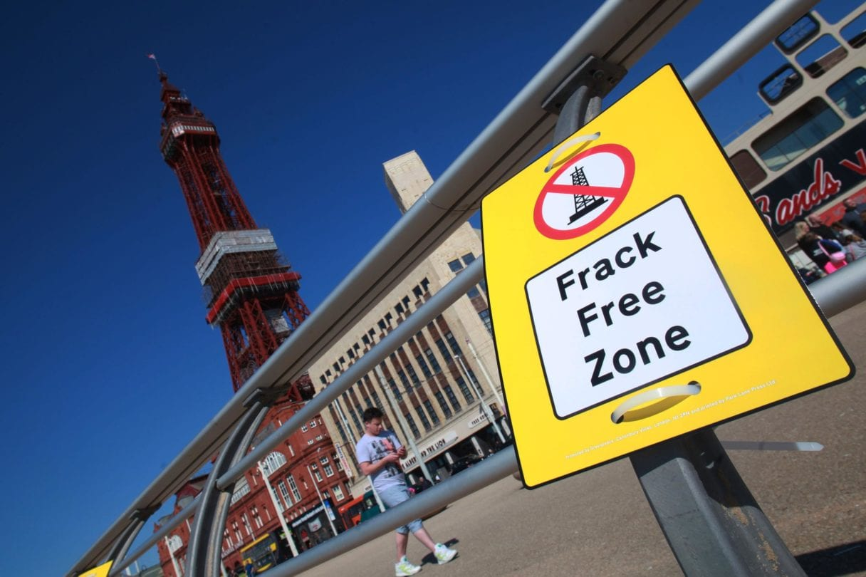 """frack free zone"" sign hanging on Blackpool pier"