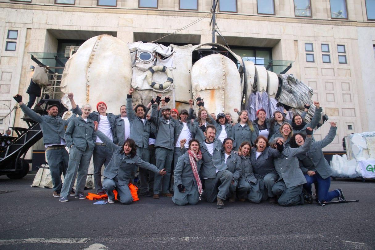 giant polar bear replica with volunteers