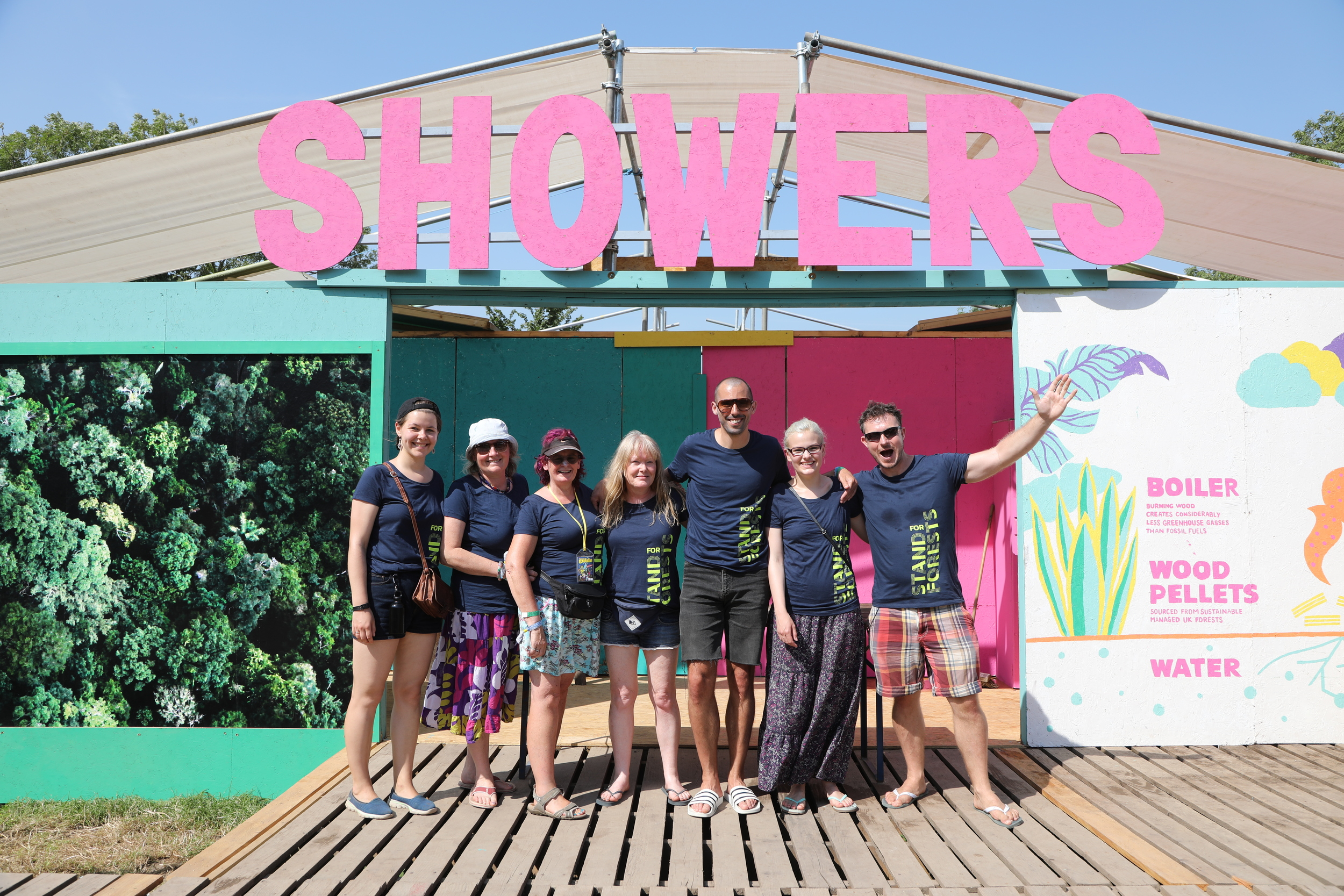 volunteers outside festival showers