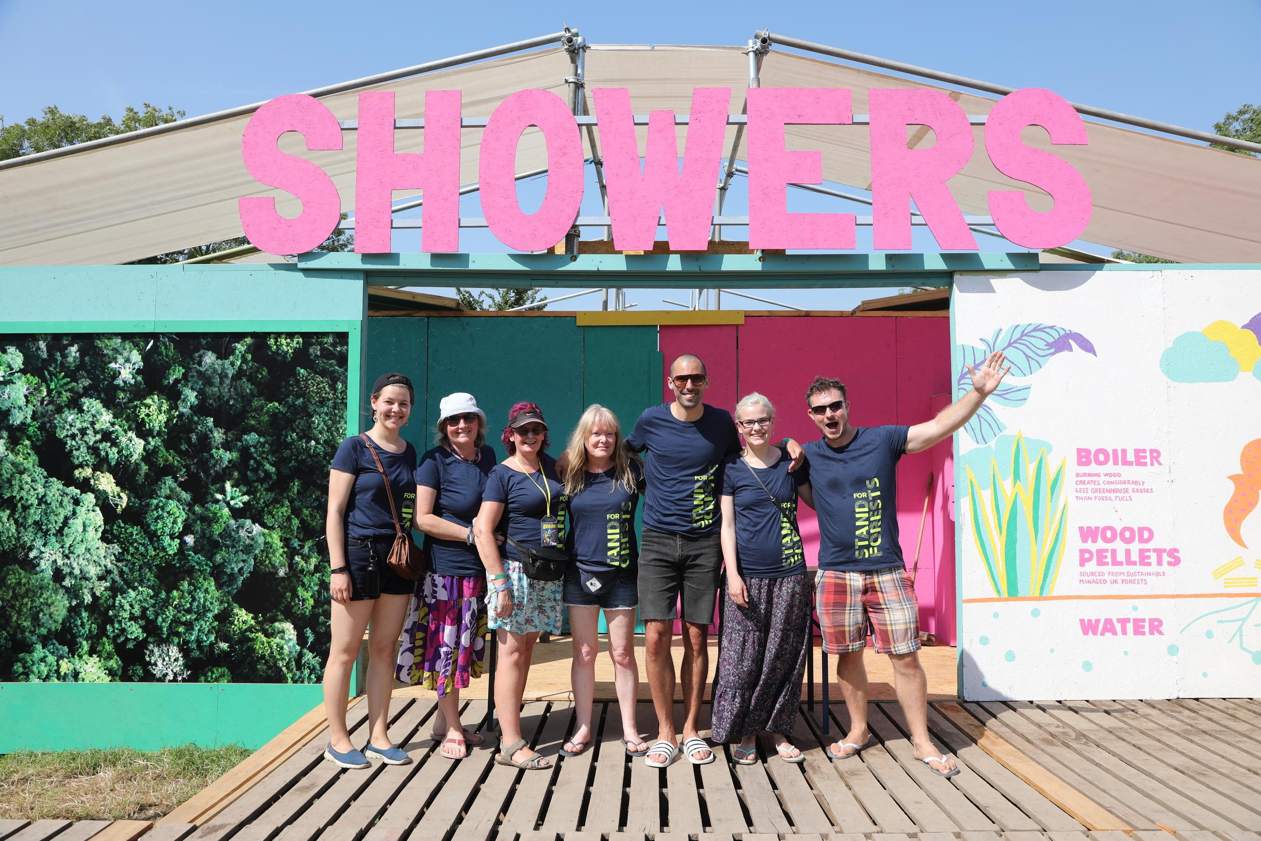 volunteers outside festival showers