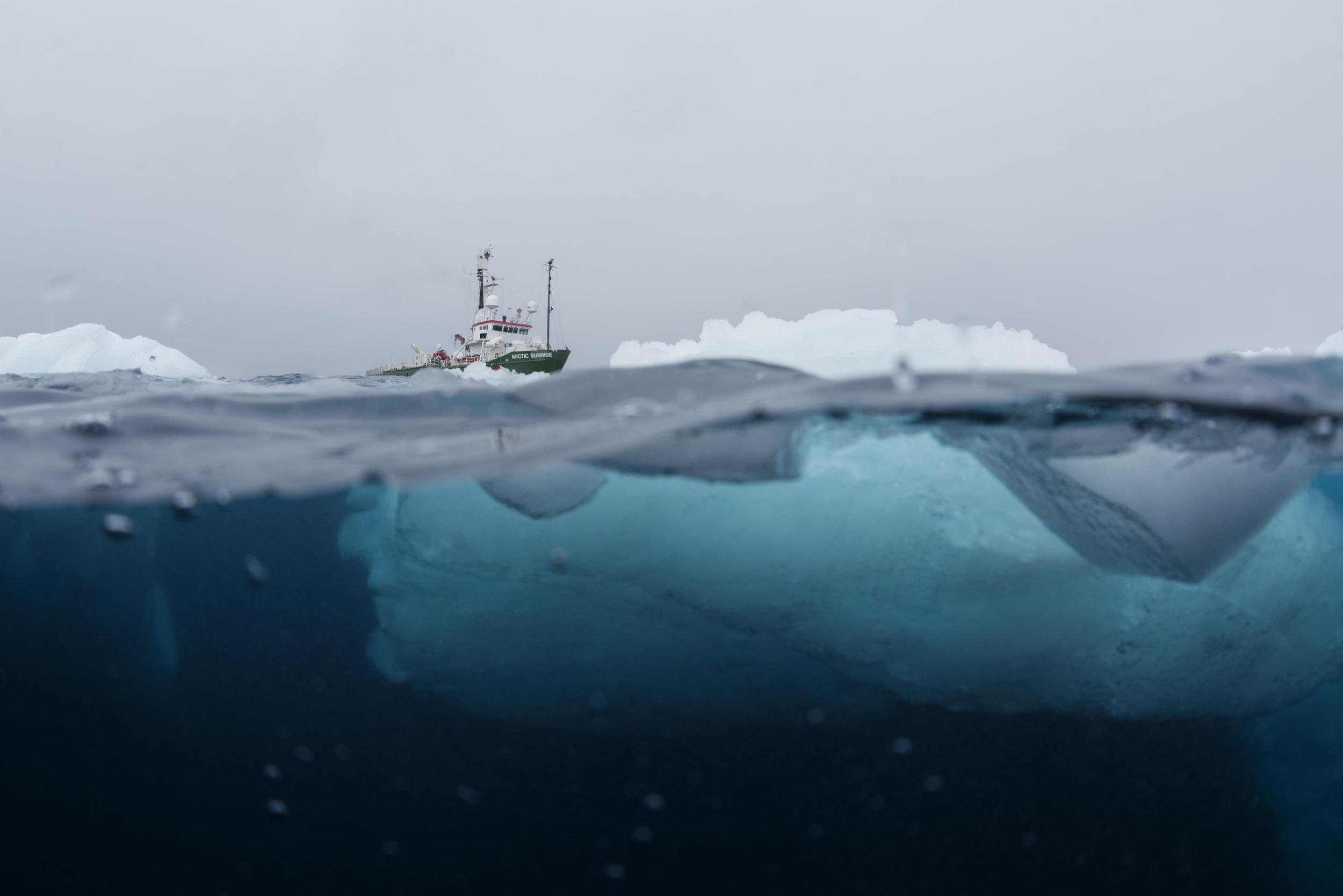 half under water half above water shot of iceberg