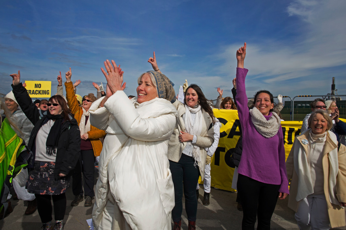 Women clapping and cheering at anti-fracking protest
