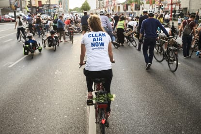 Cyclist with Clean Air Now t-shirt
