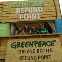 volunteers at cup and bottle refund station