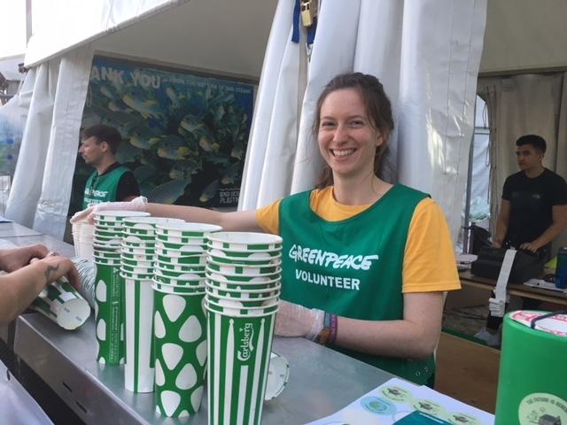 Volunteer smiling at bar