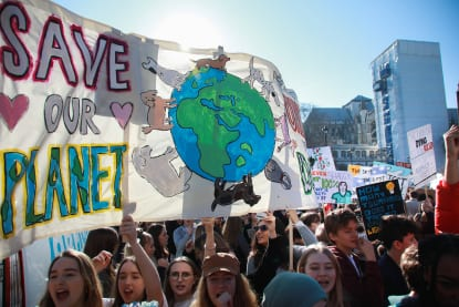 Youth climate strikers with banners