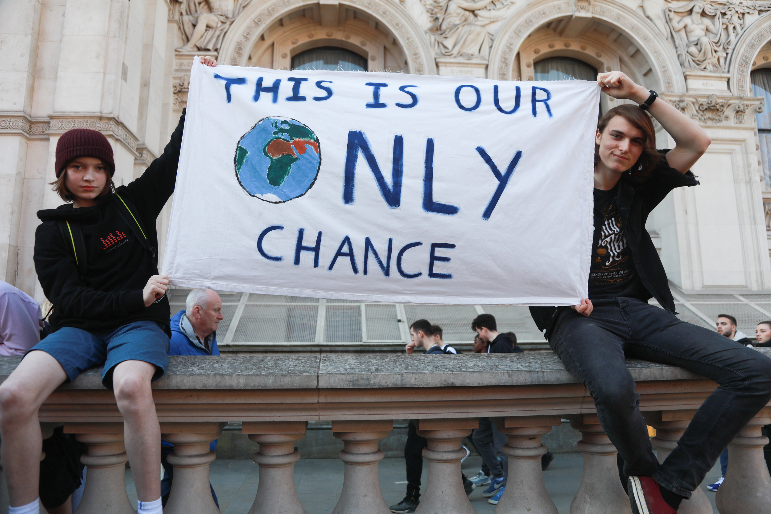 "Teenagers at a London School Strike holding a banner reading ""This is our only chance"""