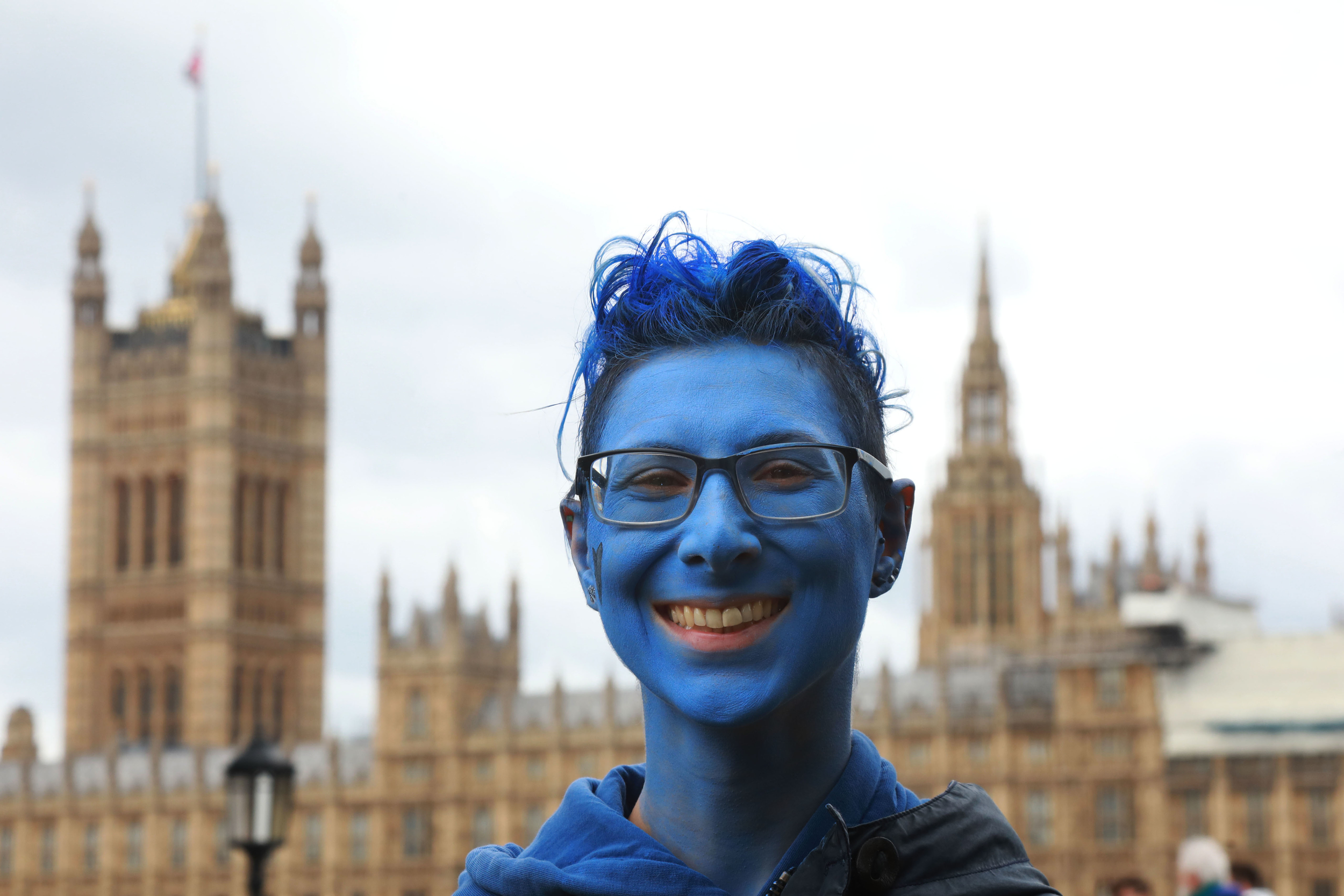 Michelle with her face painted blue with Houses of Parliament in the background.