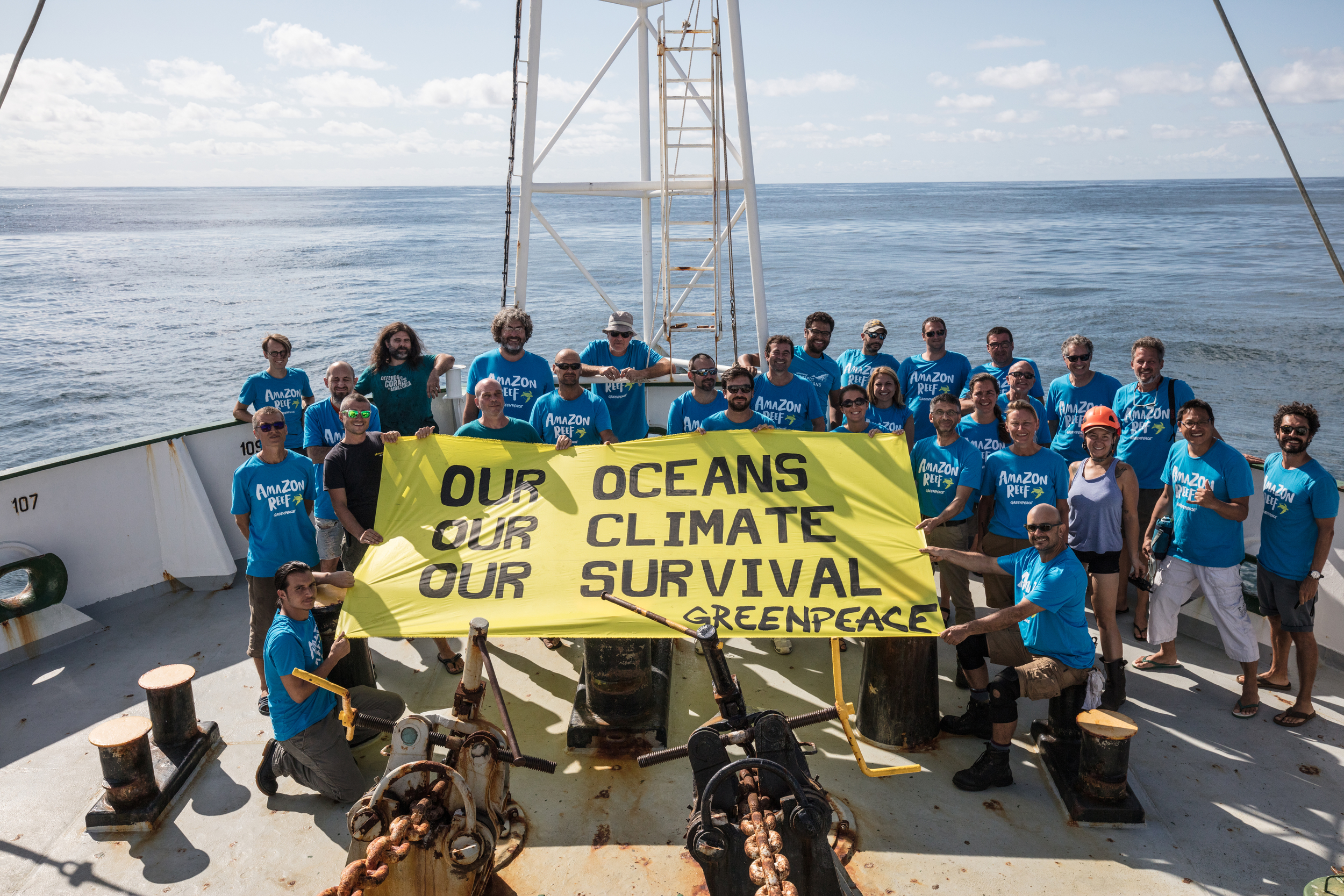 Esperanza crew holding a banner in the Amazon Reef
