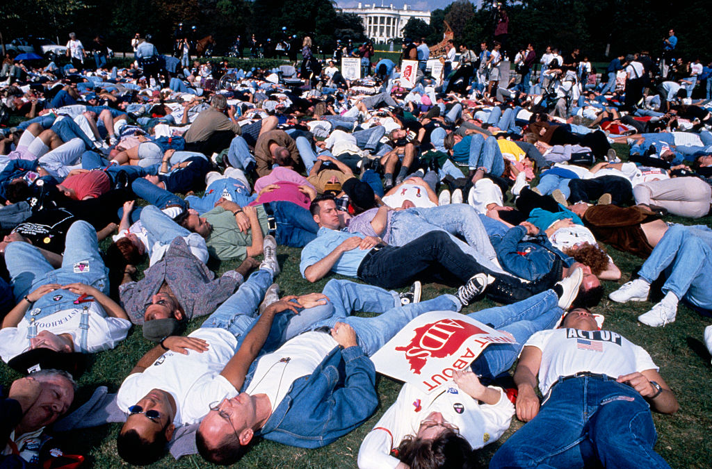 AIDS protest in front of the White House. ACT UP activists stage a die-in on the lawn in front of the Capitol building.
