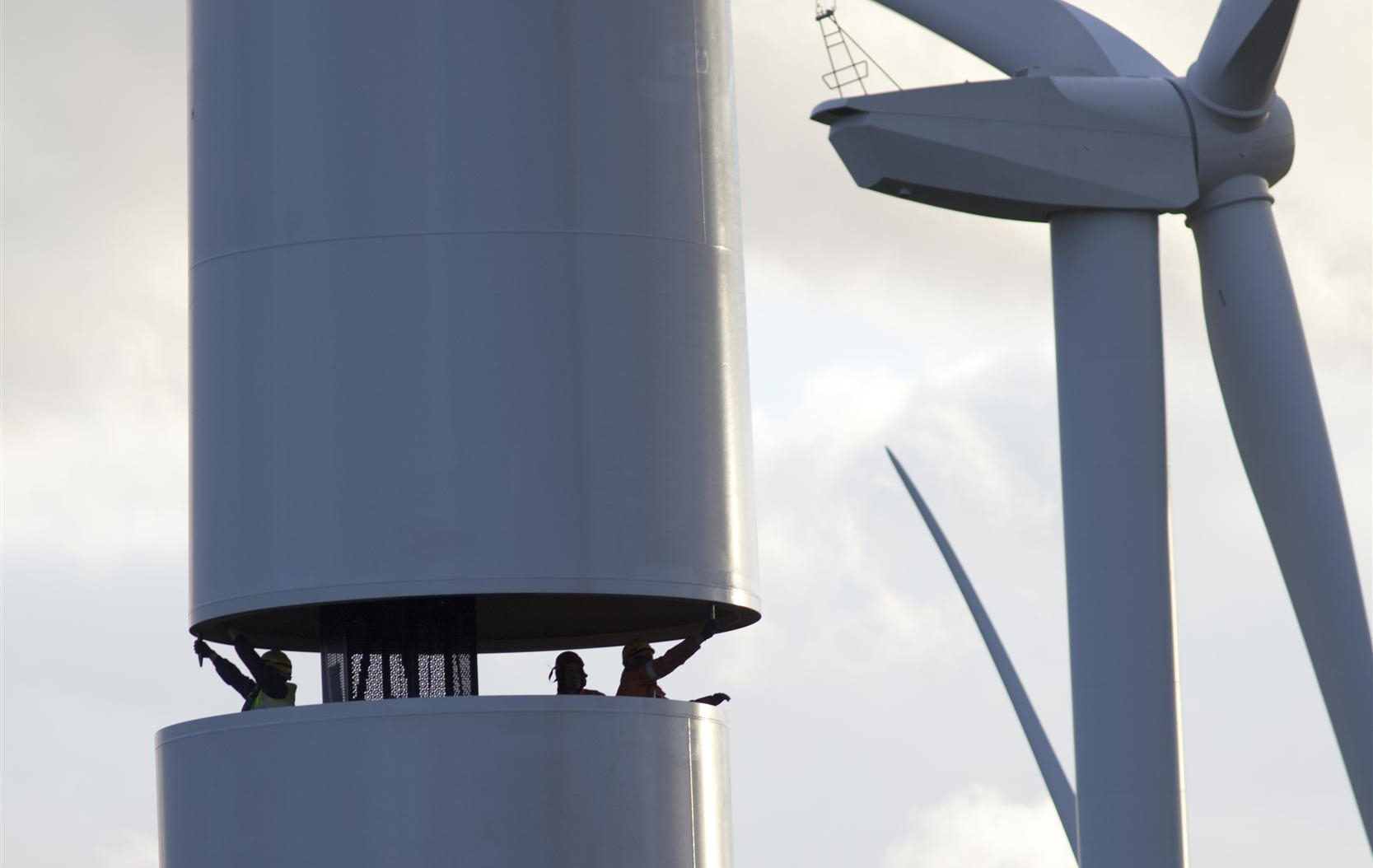 Workers building a new wind farm