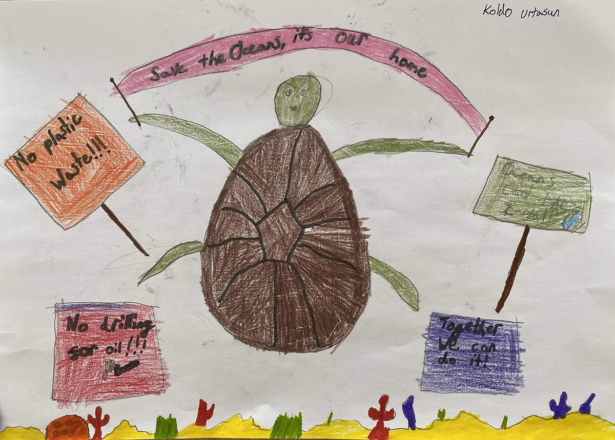 Hand-drawn child's poster showing a turtle holding up banners and placards about ocean protections in each of its flippers