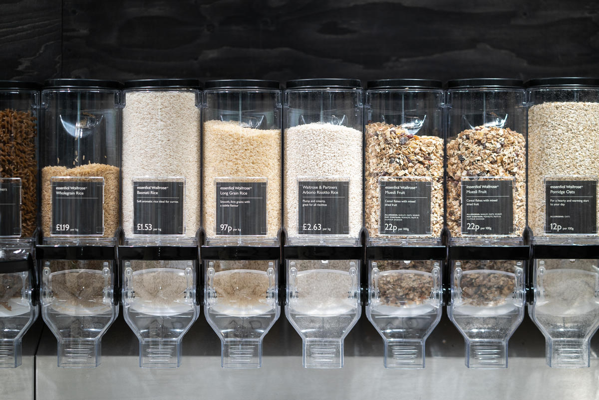 A row of dried food dispensers in a supermarket